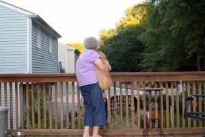 Senior Woman Holding Puppy Horizontal