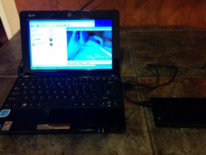 My netbook with spare laptop hard drive enclosure.