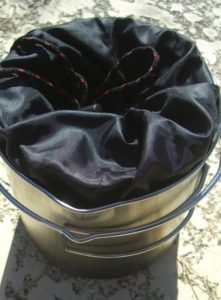 The Solo Stove Titan nestles nicely inside the Solo Stove Pot 1800.  The Solo Stove and Pot come with carrying pouches.   This helps to make sure the inside of your pot doesn't get dirty!